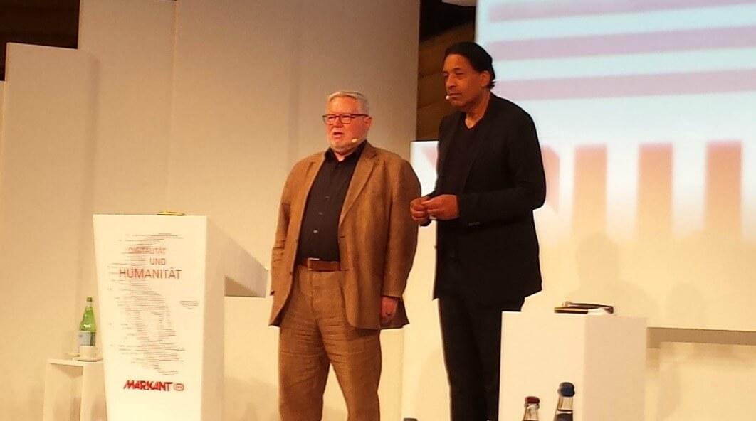 ECON Redner Anselm Bilgri mit Cherno Jobatey
